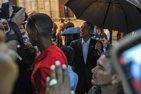President Obama talks to tourists and Cubans at the Havana Cathedral on Monday