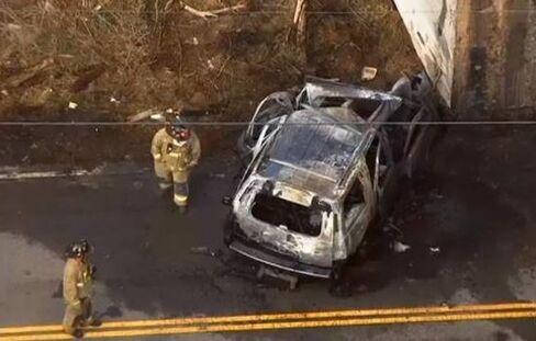 Firemen examine McClendon's Chevy