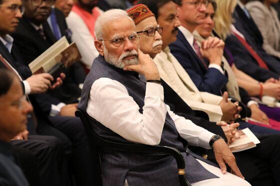 Modi's $10.6 Billion Bounty Seen Giving Little Relief to Farmers