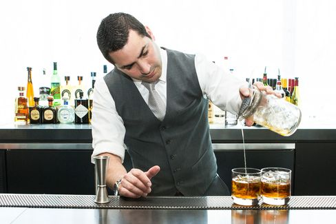 """Bartender Gabe Solano pours St. Cloud's signature """"New Amsterdam"""" cocktail, a variation on the classic Negroni."""