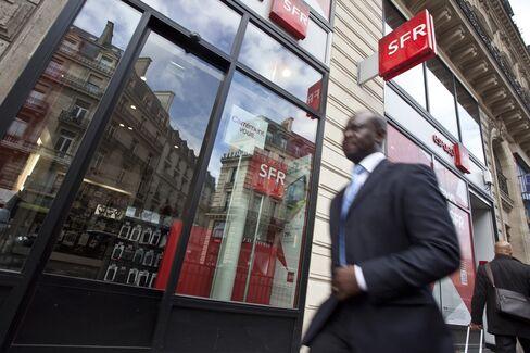 A Pedestrian Passes an SFR Store in Paris