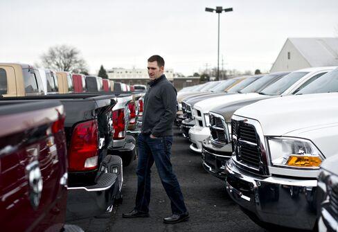 Joe DeLucia with a Dodge Ram pickup truck in Peoria, Illinois. Photographer: Daniel Acker/Bloomberg