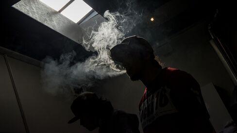 Patients smoke medicinal marijuana inside the Green Door.