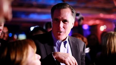 Mitt Romney is greeted by fellow Republicans at a dinner during the Republican National Committee's Annual Winter Meeting aboard the USS Midway on January 16, 2015 in San Diego, California.
