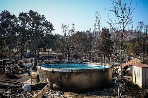 Burned residences, vehicles and a pool line a fire-ravaged neighborhood in Lower Lake, California, on August 16.
