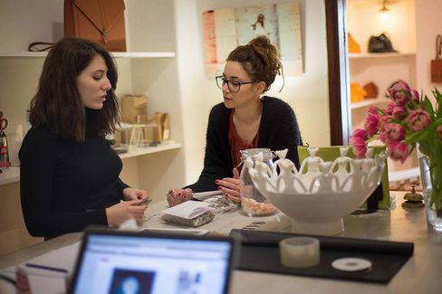 Pavlina Papailiopoulou (right) in the Ippolito boutique in central Athens.