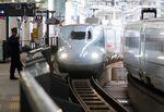 Kyushu Shinkansen bullet train approaches to Kumamoto Station.
