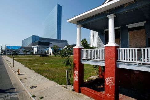 An abandoned home stands near the Revel.