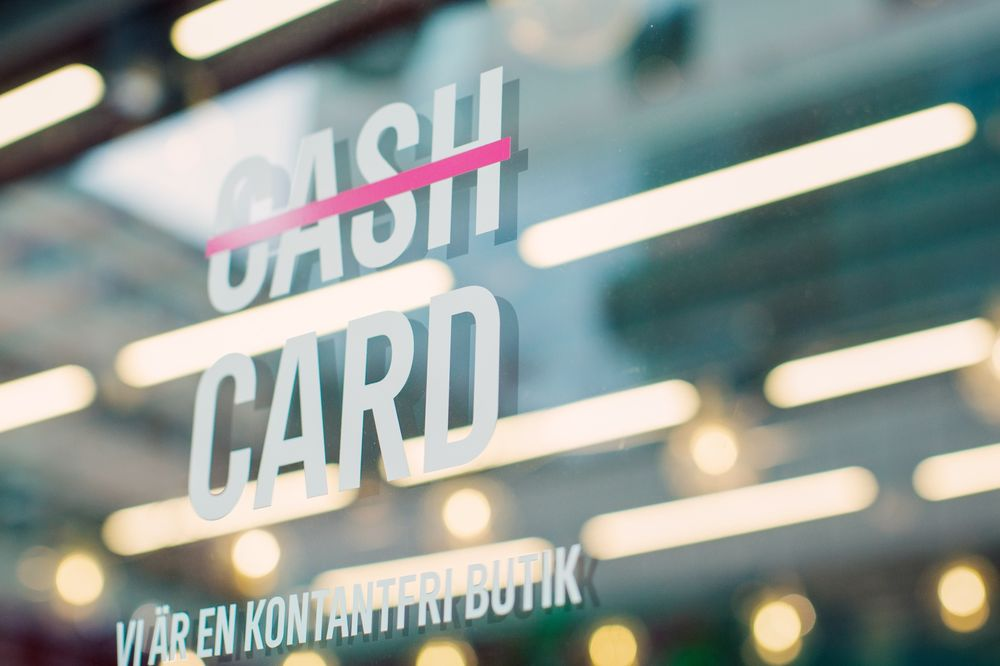 "A sign for ""we are a cashless shop"" on a store in Stockholm."