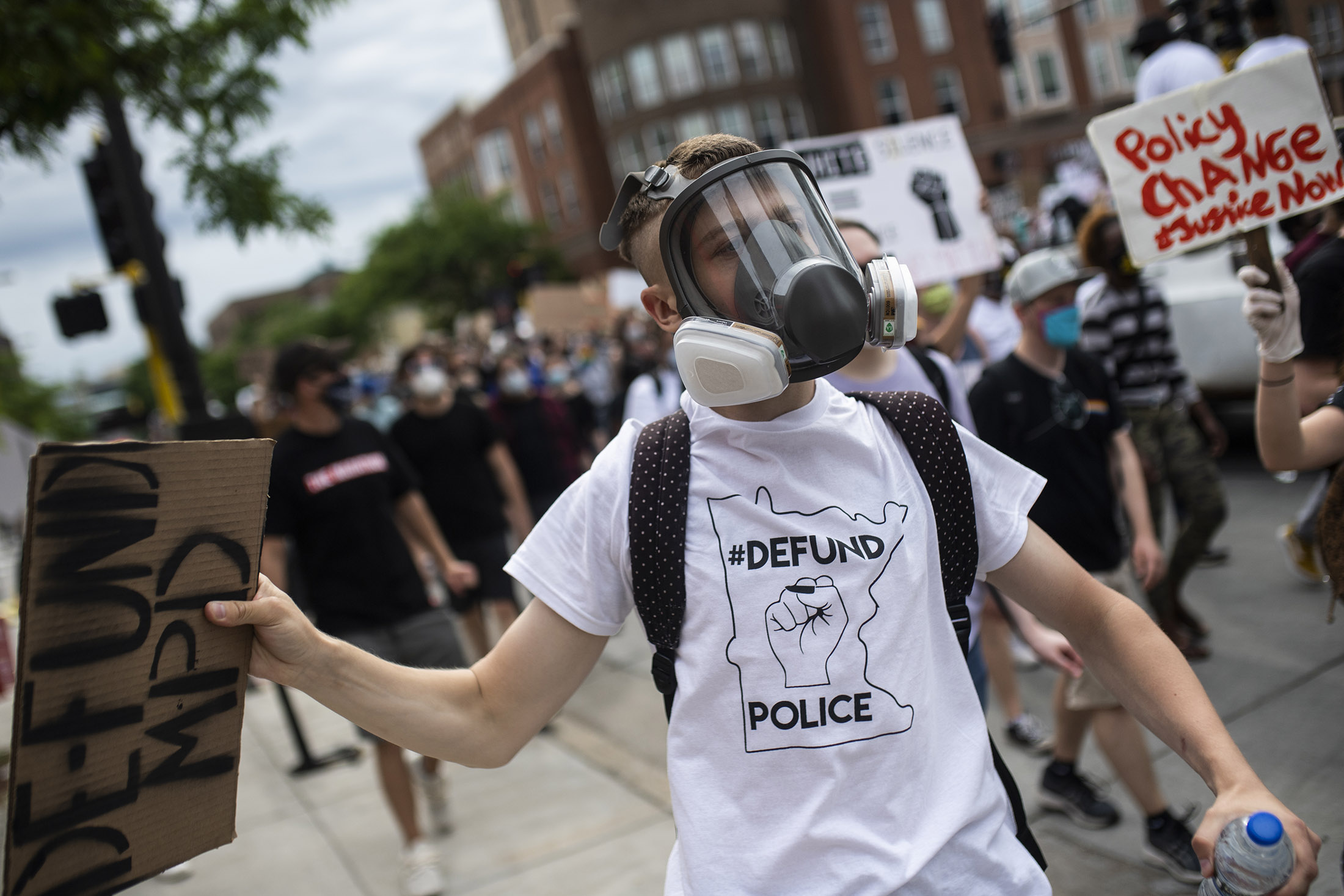 A demonstrator wears a defund police T shirt during a protest in Minneapolis on June 6.