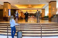 relates to Luxury Hotels Face New Conundrum: Offering Service Without the Smile