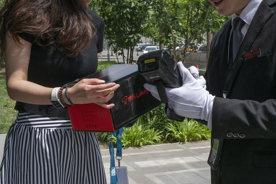 Online Shopping in China Goes Luxury, With Men in Black Delivering Hermes
