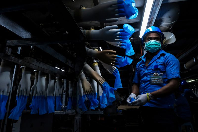 Top Glove, The World's Biggest Glovemaker, Raises Money as Virus Fuels Demand