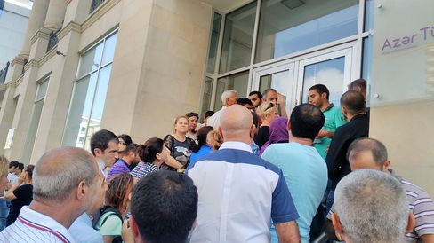 People queue outside an Azer Turk bank branch in Baku on Sept. 5.