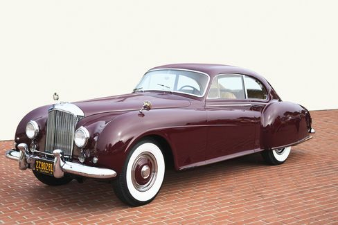 The graceful 1954 Bentley R-Type Continental features an alloy body and a powerful inline 6-cylinder engine. This was the last car Bentley made with a stick-shift gearbox - and it came as an option.