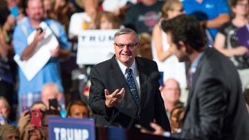 Maricopa County Sheriff Joe Arpaio takes the stage to introduce Republican presidential candidate Donald Trump at a rally at the Phoenix Convention Center on July 11, 2015.