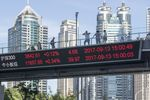 The key index of Shanghai and Shenzhen Stock Exchanges is displayed on a monitor hanging from a pedestrian overpass at Lujiazui on September 13, 2017 in Shanghai, China.
