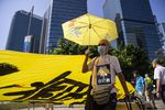 Demonstrators display a banner during a protest outside the Legislative Council building in Hong Kong, China, on Wednesday, Oct. 16, 2019.