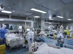 Medical personnel work in the intensive care unit of a hospital designated for COVID-19 patients in Wuhan on Feb. 24, 2020.