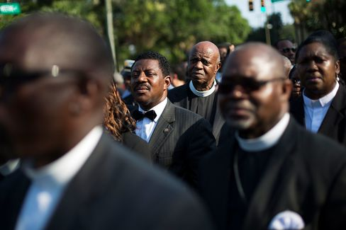 Clergy members wait to enter the funeral service for Sen. Clementa Pinckney, Friday, June 26, 2015, in Charleston, S.C. President Barack Obama will deliver the eulogy at Pinckney's funeral at a college arena near the Emanuel AME Church, the scene of last week's shooting.
