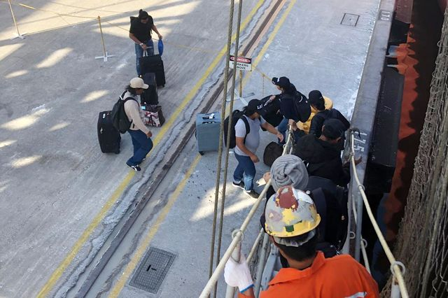 Burmese seafarers disembark from the Unison Jasper at the Port of Newcastle, Australia. Seven of the ship's 22 crew sought the help of International Transport Workers' Federation and have been repatriated.