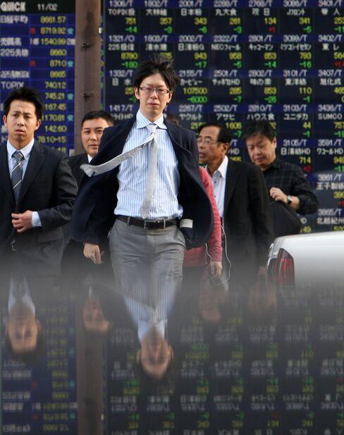 Japanese Stocks Fall as Berlusconi Struggles