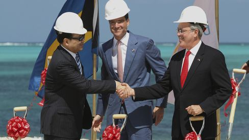 Izmirlian, center, Export-Import Bank of China President Ruogu, left, and Bahama's Deputy Prime Minister Symonette.