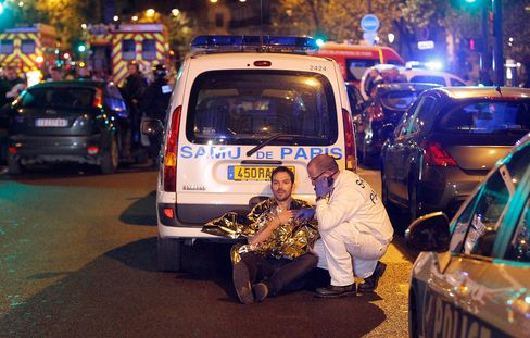 A medic tends to a man in Paris, on Nov. 13.