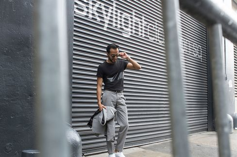 Moti outside Skylight Clarkson Square, the official venue of NYFWM, in a custom cotton suit by Born toTailor and T-shirt by Rag & Bone.