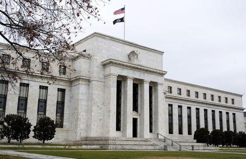 Two Fed Skeptics Say Inflation Underscores Program Risks