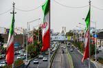 National flags of Iran flyin Tehran.