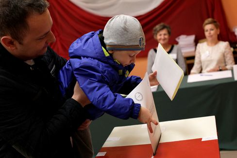 A voter casts a ballot in the Polish general election in Brzeszcze.