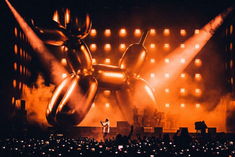 Jay-Z performs at the V Festival in front of a Jeff Koons balloon dog sculpture in August 2017.