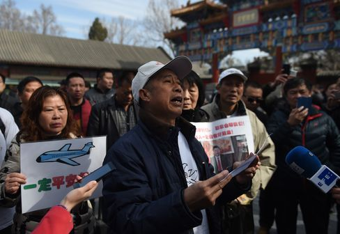 Relatives of Flight 370 victims gather outside Lama Temple in Beijing.