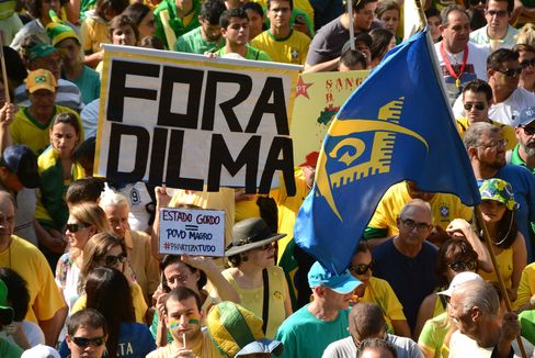 People gather to protest against President Dilma Rousseff and her ruling coalition in São Paulo on April 12, 2015. s