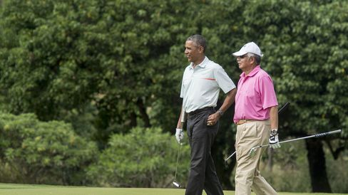 US President Barack Obama and Malaysian Prime Minister Najib Razzak walk on the green as they play golf at Marine Corps Base Hawaii on December 24, 2014..
