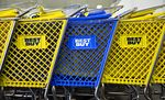 Shopping carts sit lined up at the entrance of a Best Buy Co. store