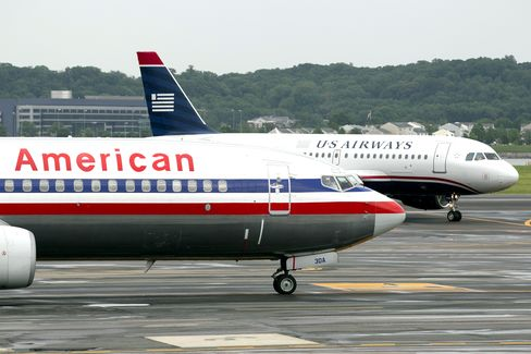 AMR, US Airways Said to Agree on Merger Terms as Board Votes Set