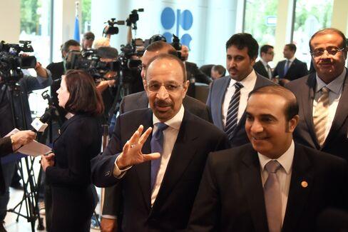 Khalid Al-Falih, center, arrives at the OPEC conference on June 2.