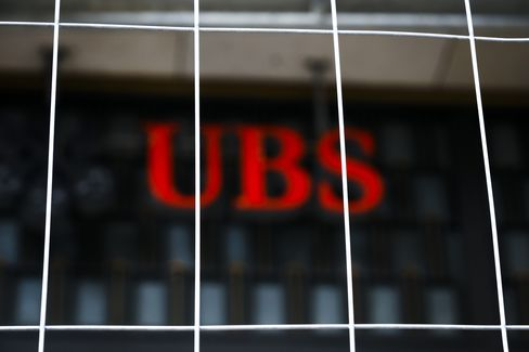 UBS Posts Quarterly Loss on Libor Fine, Reorganization Cost