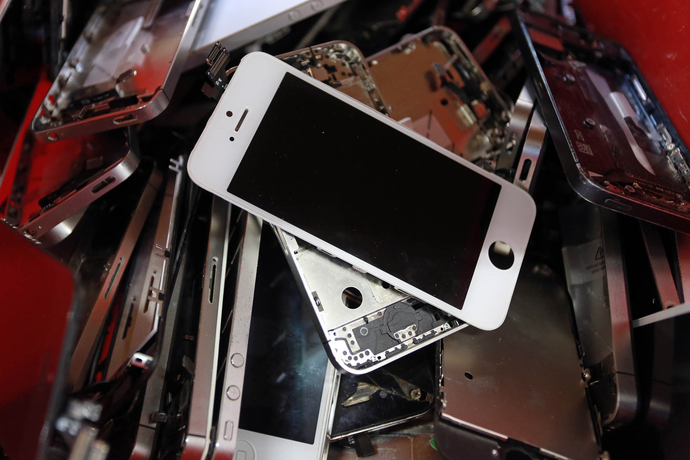 At the end of their useful lives, many iPhones face the crusher.