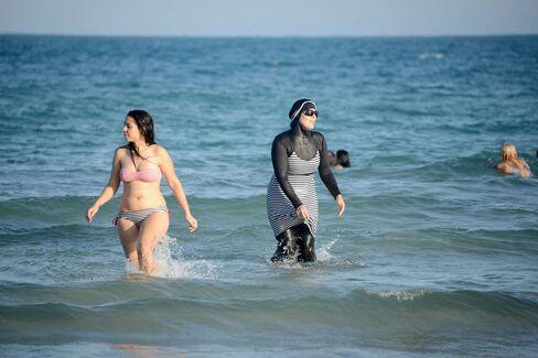 "A woman wearing a ""burkini""."