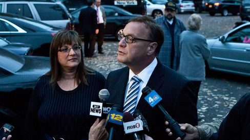 New Jersey U.S. Senate candidate Steve Lonegan and his wife Lorraine Rossi Lonegan speaks with members of the media at a polling center on October 16, 2013 in Bogota, New Jersey