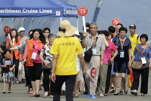 Tourists Arrive On The Quantum Of The Seas Cruise Liner As Shanghainese Lead China's Tourism Surge In Japan