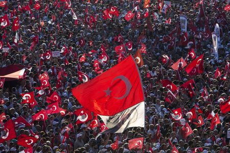 Political supporters wave Turkish national flags during a pro democracy demonstration in Istanbul.