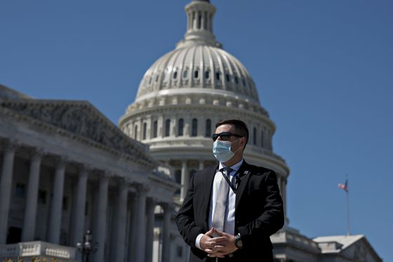Masked Lawmakers to Vote in Person to Pass $484 Billion Stimulus