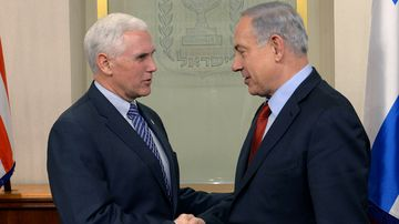 In this handout provided by the Israeli Government Press Office, Prime Minister Benjamin Netanyahu, right, shakes hands with Indiana Governor Mike Pence on Dec. 29, 2014, in Jerusalem.