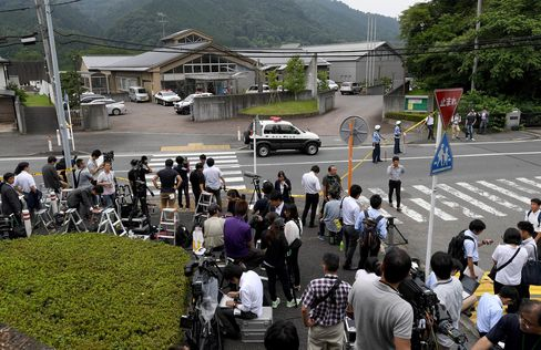 Journalists gather in front of the Tsukui Yamayuri En care center in Sagamihara, Kanagawa prefecture on July 26.