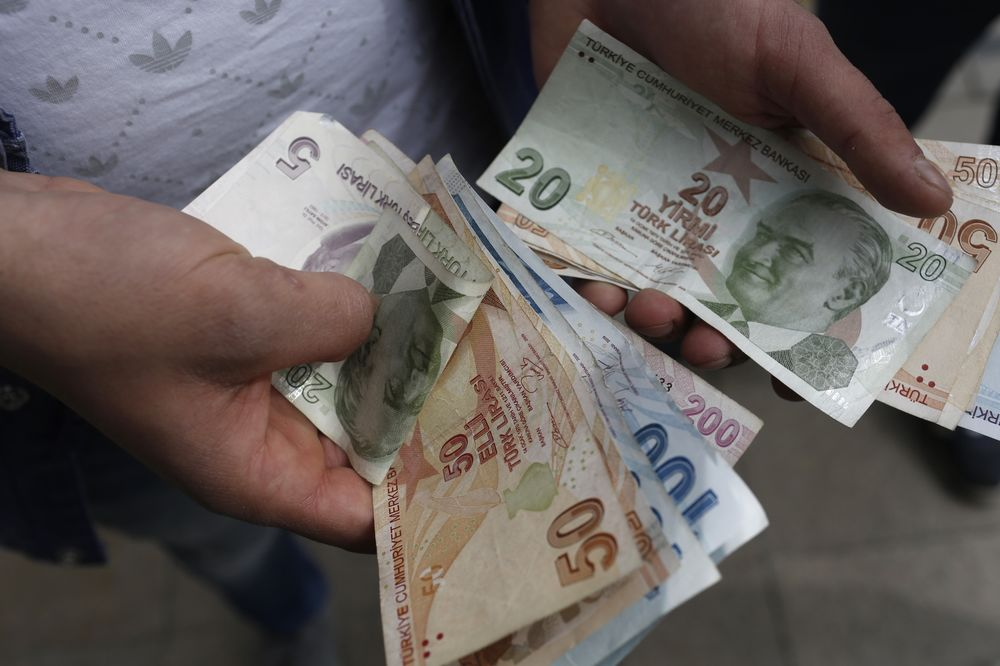 A Customer Counts Turkish Lira Banknotes After Visiting Currency Exchange In Istanbul Turkey