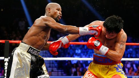 Floyd Mayweather Jr. throws a right at Manny Pacquiao during their welterweight unification championship bout on May 2, 2015, at MGM Grand Garden Arena in Las Vegas.